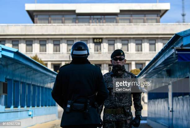 South Korean soldiers stand guard at the border village of Panmunjom in the Demilitarized Zone between South and North Korea on February 7 2018 in...
