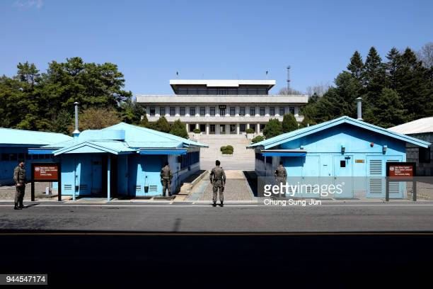 South Korean soldiers stand guard at the border village of Panmunjom between South and North Korea at the Demilitarized Zone on April 11, 2018 in...
