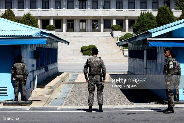 South Korean soldiers stand guard at the border village of Panmunjom between South and North Korea at the Demilitarized Zone on April 11 2018 in...