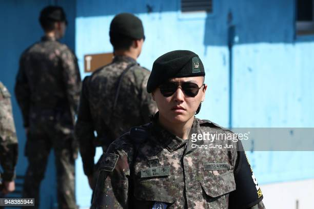 South Korean soldiers stand guard at the border village of Panmunjom between South and North Korea at the Demilitarized Zone on April 18 2018 in...