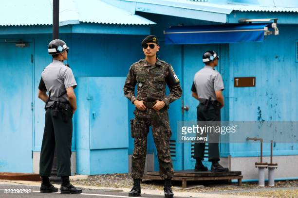 South Korean soldiers stand guard at the truce village of Panmunjom in the Demilitarized Zone in Paju South Korea on Thursday July 27 2017 South...