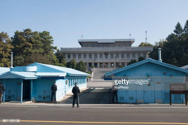 South Korean soldiers stand guard facing a North Korean guard in the Joint Security Area in Panmunjom area of the Demilitarized Zone on October 14...