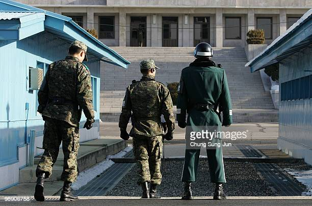 South Korean soldiers stand guard near the South side of the border in the village of Panmunjom between South and North Korea in the demilitarized...
