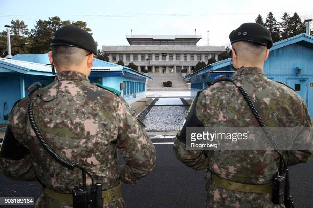 South Korean soldiers stand guard near the United Nations Command Military Armistice Commission conference buildings at the truce village of...