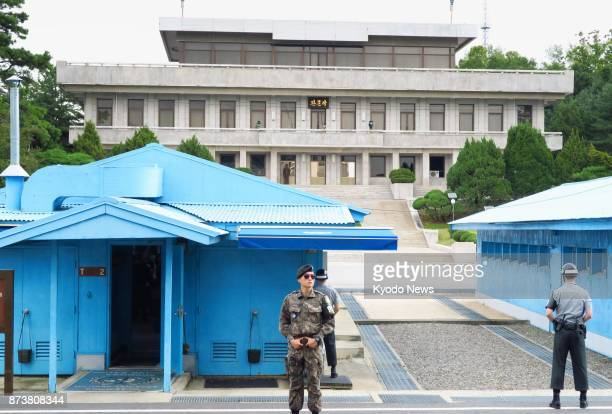 South Korean soldiers stand guard on Sept 30 2017 in front of North Korea's main building in a joint security area at the border village of...