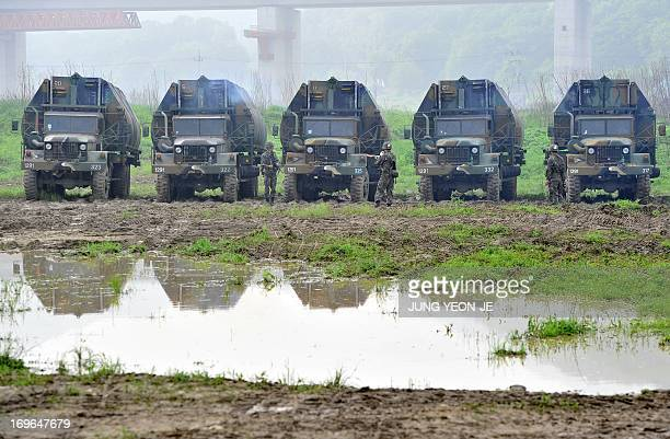 South Korean soldiers stand in front of military trucks containing floating bridge during a USSouth Korea joint river crossing exercise in the border...
