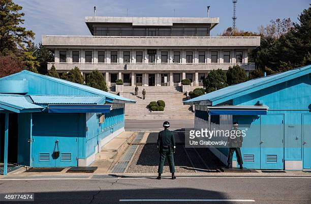 South Korean soldiers standing at the military demarcation line separating North and South Korea within the Joint Security Area on November 01 in...
