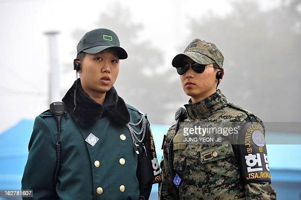 South Korean soldiers stands guard as journalists visit the truce village of Panmunjom in the demilitarized zone dividing North and South Korea on...