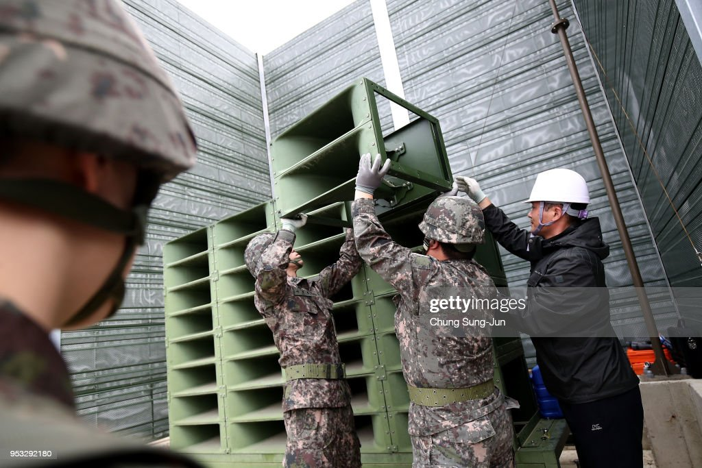 South Korean soldiers take down a propaganda loudspeakers on the border with North Korea on May 1, 2018 in Paju, South Korea. South Korea's military pulled back all high-decibel loudspeakers installed along the border with North Korea in its first step to implement the bilateral summit agreement reached last week.