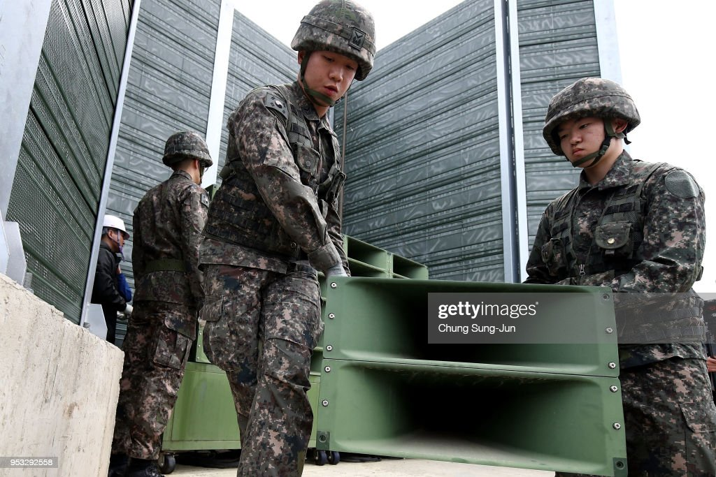 South Korean soldiers take down a propaganda loudspeakers on the border with North Korea on May 1, 2018 in Paju, South Korea. South Korea's military pulled back all high-decibel loudspeakers installed along the border with North Korea, in its first step to implement the bilateral summit agreement reached last week.