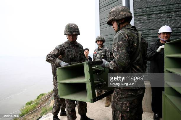 South Korean soldiers take down a propaganda loudspeakers on the border with North Korea on May 1 2018 in Paju South Korea South Korea's military...