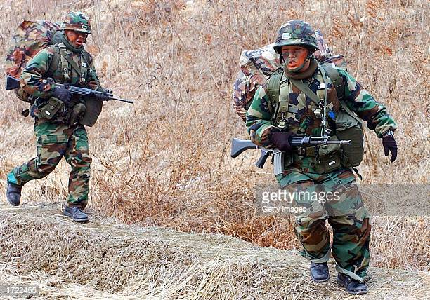 South Korean soldiers train near the demilitarized zone which separates the country from communist North Korea January 13 2003 in Paju north of Seoul...