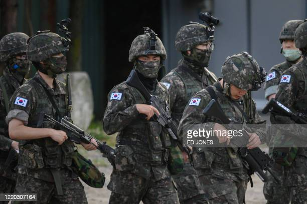 South Korean soldiers walk along a road in Inje county near South Korea's northeast border on June 16 2020 North Korea blew up an interKorean liaison...
