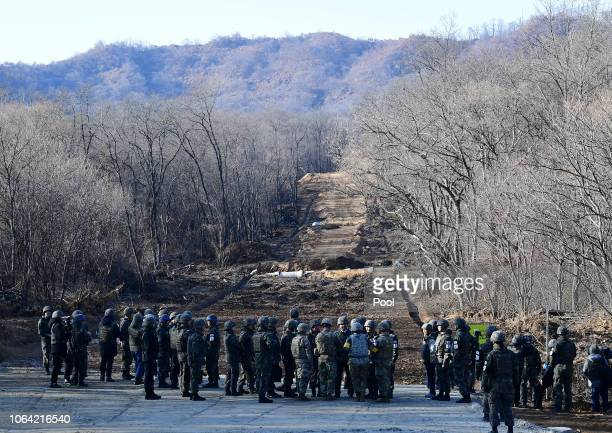 South Korean soldiers walk at Arrowhead Ridge a site of fierce battles in the 195053 Korean War to build a tactical road across the Military...