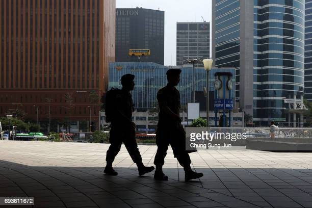 South Korean soldiers walk at the Seoul Railway Station on June 8 2017 in Seoul South Korea According to the South Korean military North Korea...