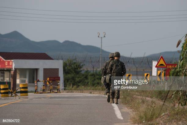South Korean soldiers walk to a checkpoint at the Demilitarized zone separating North and South Korea on Ganghwa island on September 4 2017 North...