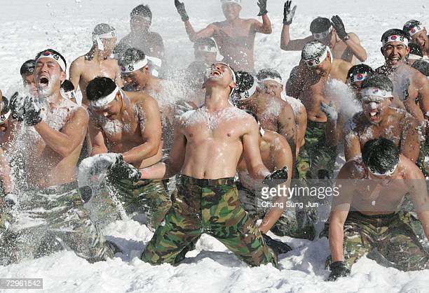 South Korean special warfare forces cover themselves in snow during winter mountain training exercises on January 10 2007 in PyeongChang South Korea...