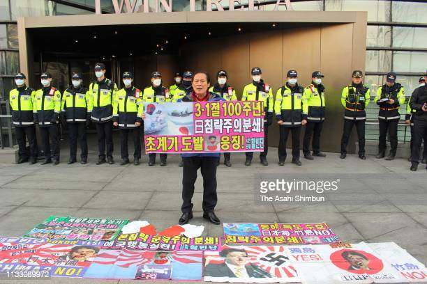 South Korean stands in front of the building where Japanese Embassy is located during a rally marking March First Independence Movement against...