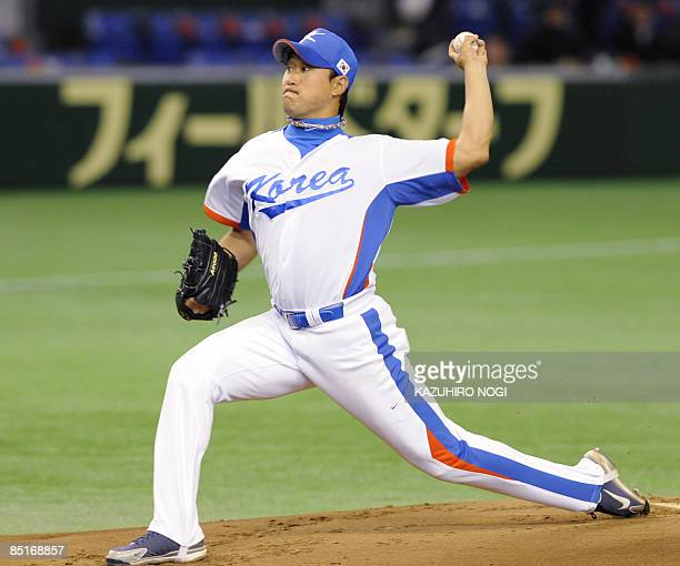 South Korean starting pitcher Bong JungKeun throws in the first inning against Japan's Seibu Lions during their exhibition game ahead of the World...