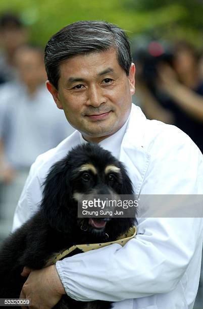 South Korean stem cell researcher Dr Hwang WooSuk holds 'Snuppy' during an announcement of his first successfully cloned Afghan hound at the Seoul...