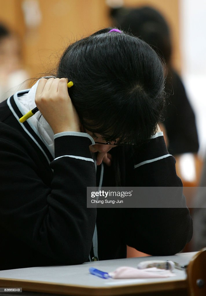 A South Korean student takes her College Scholastic Ability Test at a school on November 13, 2008 in Seoul, South Korea. More than 580,000 high school seniors and graduates sit for the examinations at 996 test centers across the country. Success in the exam enables students to study at Korea's top universities.