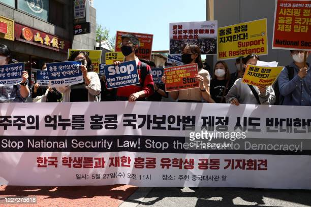 South Korean students participate in a rally to support Hong Kong prodemocracy protests near the Chinese embassy on May 27 2020 in Seoul South Korea...