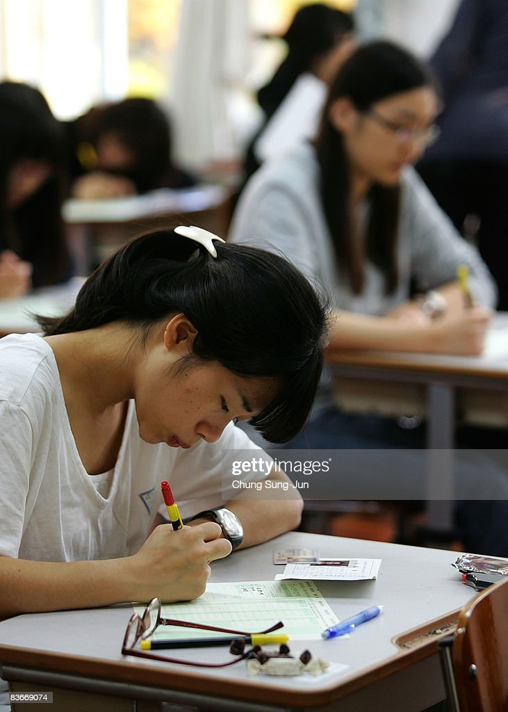 South Korean students take their College Scholastic Ability Test at a school on November 13, 2008 in Seoul, South Korea. More than 580,000 high school seniors and graduates sit for the examinations at 996 test centers across the country. Success in the exam enables students to study at Korea's top universities.