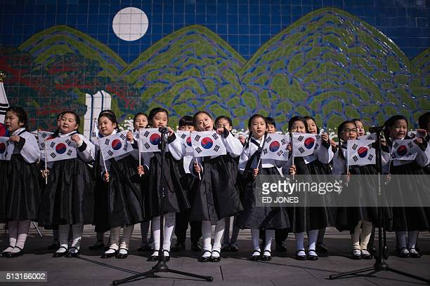 South Korean students wearing traditional costumes perform prior to an anti-Japan protest marking the 97th Independence Movement Day in Seoul on...