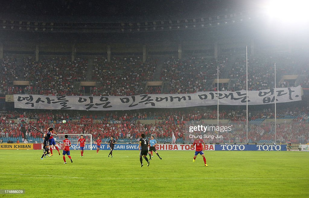 South Korean supporters show a banner 'A nation that forgets history has no future' during the EAFF East Asian Cup match between Korea Republic (South Korea) and Japan at Jamsil Stadium on July 28, 2013 in Seoul, South Korea.