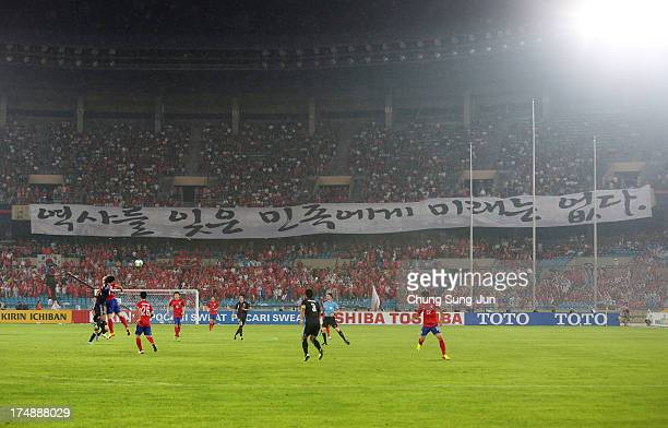 South Korean supporters show a banner 'A nation that forgets history has no future' during the EAFF East Asian Cup match between Korea Republic and...