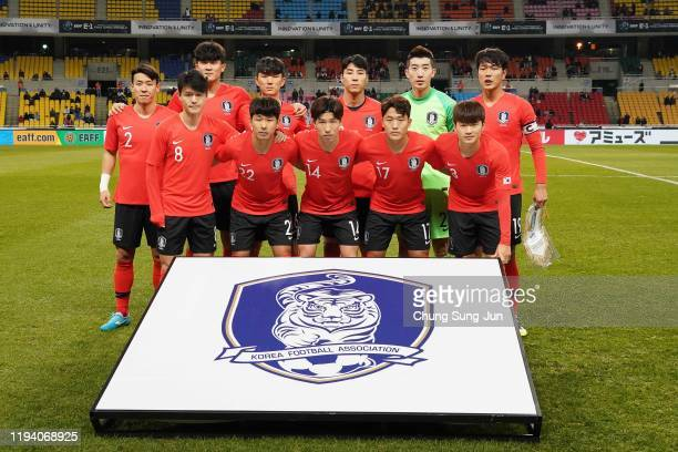 South Korean team line up during the EAFF E-1 Football Championship match between South Korea and China at Busan Asiad Main Stadium on December 15,...
