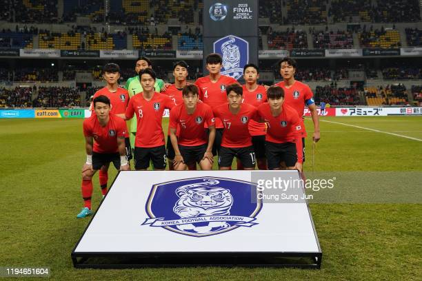 South Korean team line up during the EAFF E-1 Football Championship match between South Korea and Japan at Busan Asiad Main Stadium on December 18,...