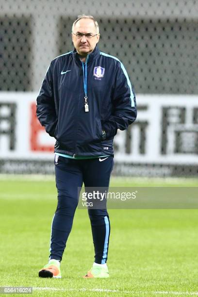South Korean team manager Uli Stielike attends a training session before the 2018 FIFA World Cup Qualifiers match against South Korea on March 22...