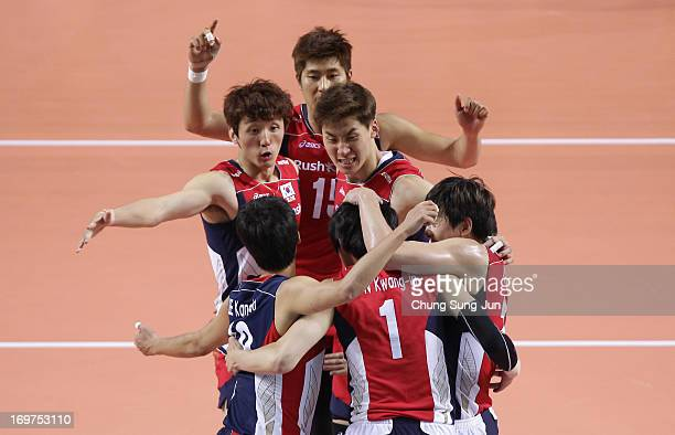 South Korean team players celebrate after scoring a point during FIVB World League Pool C match between South Korea and Japan at Hwasung Indoor...