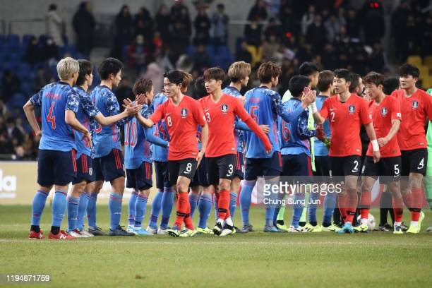 South Korean team players shakes hands with Japanese team players after the EAFF E-1 Football Championship 2019 between Japan and South Korea at...