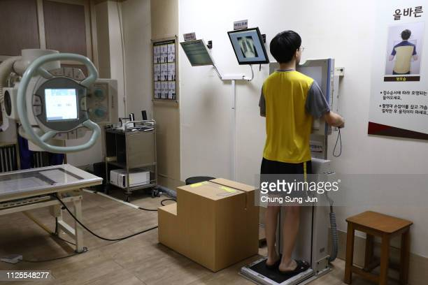 South Korean teenager participates in a an Xray test during his physical examination for conscription at the South Korean Military Manpower...