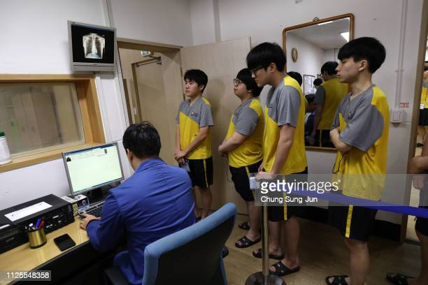South Korean teenagers participate in a an Xray test during their physical examination for conscription at the South Korean Military Manpower...