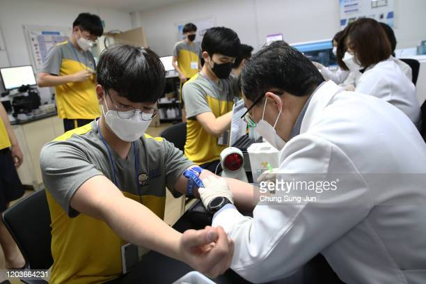 South Korean teenagers wear protective face masks in light of the outbreak of the novel coronavirus known as 2019nCoV during their physical...