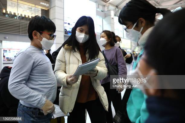 South Korean teenagers wearing masks at the Incheon International Airport on January 27 2020 in Incheon South Korea South Korea confirmed its fourth...