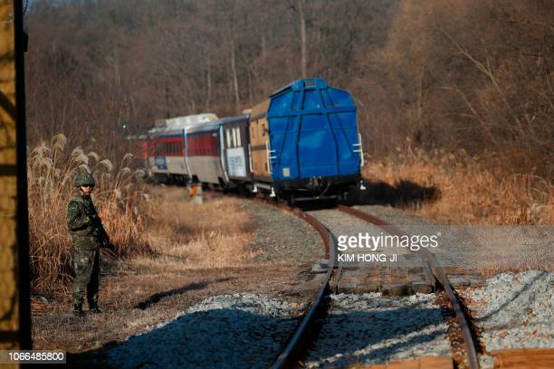 South Korean train trainsporting dozens of South Korean officials travels on the rails which leads to North Korea inside the demilitarized zone...
