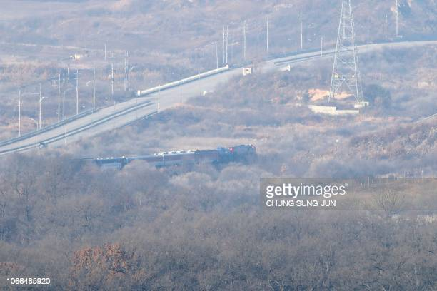 South Korean train trainsporting dozens of South Korean officials runs on the rails which leads to North Korea inside the demilitarized zone...