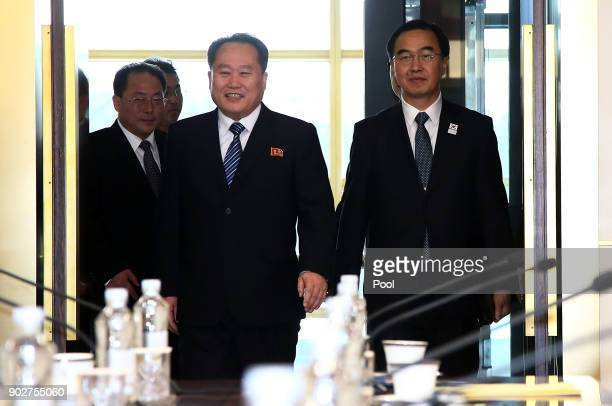 South Korean Unification Minister Cho Myounggyon and head of North Korean delegation Ri SonGwon walk into a meeting room before their meeting at the...