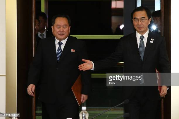 South Korean Unification Minister Cho MyoungGyon and the head of the North Korean delegation Ri SonGwon arrive to hold their meeting at Panmunjom in...