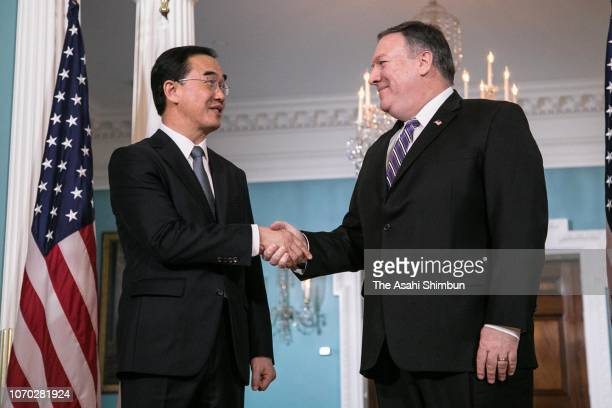 South Korean Unification Minister Cho Myounggyon and US Secretary of State Mike Pompeo shake hands prior to their meeting on November 16 2018 in...