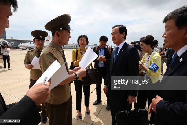 South Korean Unification Minister Cho Myounggyon has their identity checked from North Korea officials as he arrives at Pyongyang Sunan International...