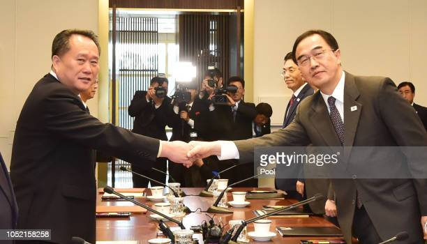 South Korean Unification Minister Cho Myounggyon shakes hands with North Korean delegation head Ri Son Gwon during their highlevel talks at a border...