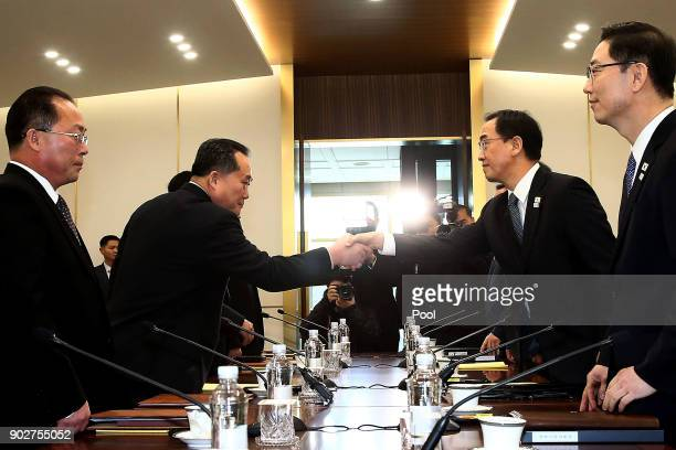 South Korean Unification Minister Cho Myounggyon shakes hands with the head of North Korean delegation Ri SonGwon before their meeting at the...