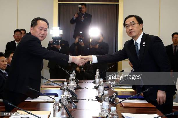 South Korean Unification Minister Cho MyoungGyon shakes hands with the head of the North Korean delegation Ri SonGwon after their meeting at...