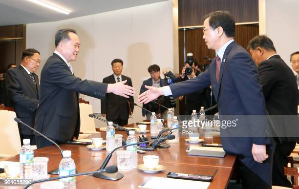 South Korean Unification Minister Cho Myounggyon shakes hands with the head of North Korean delegation Ri SonGwon during their meeting on June 1 2018...