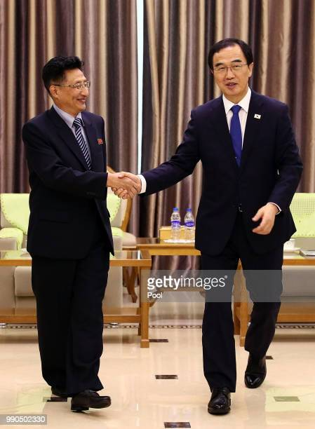 South Korean Unification Minister Cho Myounggyon shakes hands with North Korean Vice Sports Minister Won Kilu during their meeting at Pyongyang Sunan...